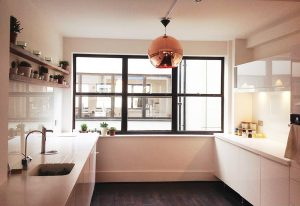 all-white-kitchen-design_copper-lighting_nesting-properties